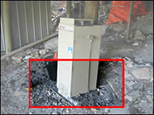 Water heater installed on an unstable timber base - and on a sloping surface.