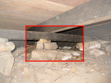 Sub floor has low clearance. Bearing has no structural integrity on rocks. No ant caps to stop termite invasion.
